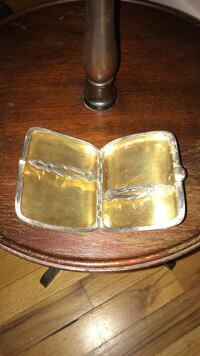 Gold-color pocket case, Bailey, Banks & Biddle- Silver with Gold Wash with Gold Button to Unlock Islip, 11742