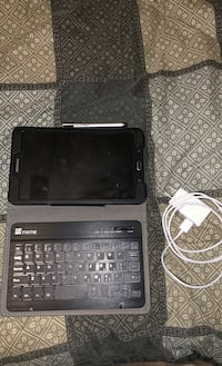 Samsung SM T377P Tablet with Case and Charger