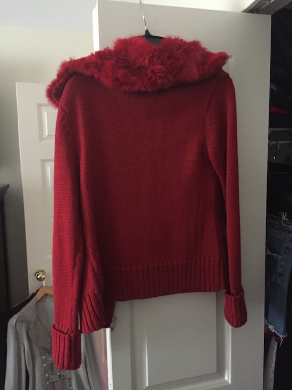 Red sweater with zipper all the way down , warm and cozy size S/M prices to go 3791b7d9-2626-425b-b0e6-13f811c9ec36