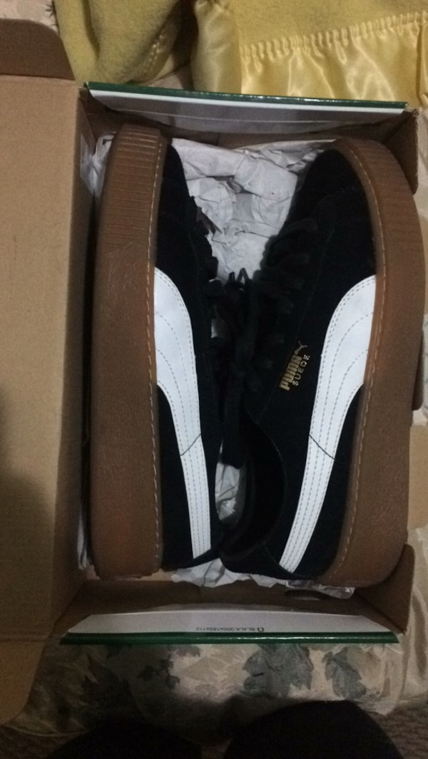 Pair of black-and-white puma sneakers