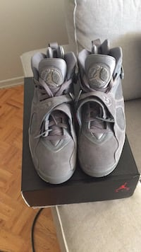 Pair of gray air jordan basketball shoes
