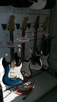 Four assorted colors stratocaster type electric guitars