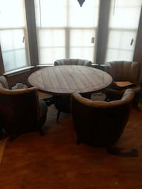 round brown wooden table with four chairs dining set Locust Grove, 30248