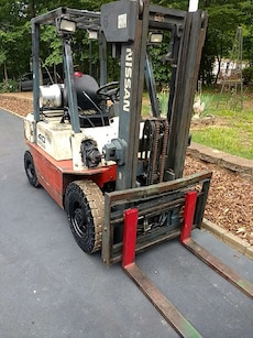 red and white Nissan fork lift