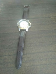 round gray case analog watch with black leather strap