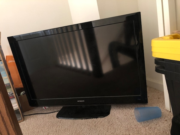 Black Hitachi flat screen tv