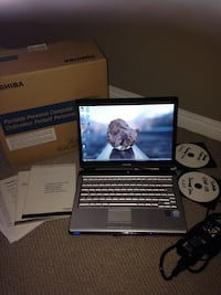 Blue and gray toshiba laptop