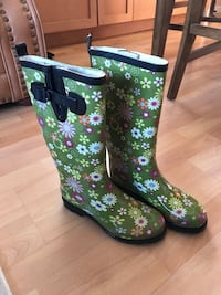 Pair of green-and-black floral rain boots North Vancouver