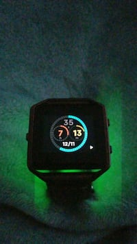 black and green digital watch 42 km
