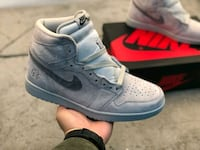 pair of gray Nike Air Force 1 low shoes New York
