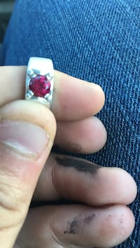 silver and red stone ring