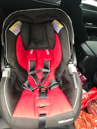 baby's black and red Recaro car seat carrier