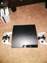 black Sony PS3 console with controllers & games Cathedral City, 92234