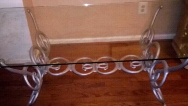 Glass table with metal base.
