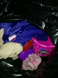Bag full of toys and coats