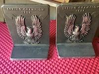pair of black Spring Champion book ends