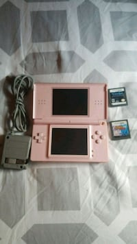 Pink Nintendo DS with game cartridges 527 mi