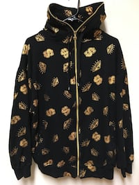 black and gold zip-up jacket