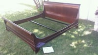 brown wooden bed frame with mattress Laval, H7W 3C5