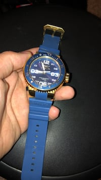 round blue and black analog watch with blue strap Murfreesboro, 37128