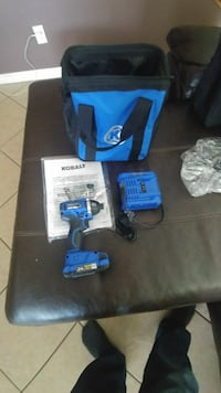 blue and black Kobalt impact wrench with charger and bag