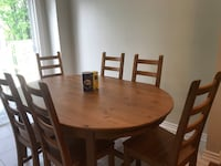 Solid wood table from Ikea Comes with 6 chairs.