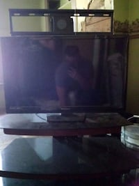 Vizio flat screen TV with tv stand. Without remote Gainesville, 76240
