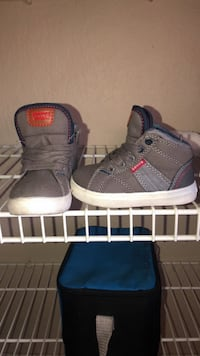 pair of gray Adidas high-top sneakers Palm Harbor, 34685