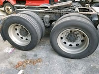 two gray bullet hole car wheels with tires River Grove, 60171