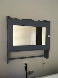 Wood cabinet with mirror Ellicott City, 21042