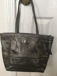Authentic Coach silver logo leather tote. Used only a few times and has two small spots on the lining   Columbia, 21046