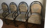 Four black metal framed brown padded armchairs Vancouver, V6B 1L1