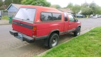 red single cab pickup truck with camper shell Tigard, 97223