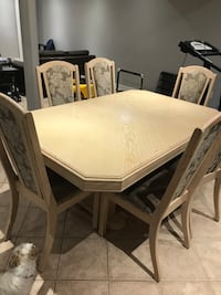 Dining set - Elegant table with insert - 2 side chairs and 6 side chairs. Some staining on chairs and table. Bolton, L7E 1C8