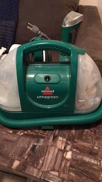 Bissell Little green carpet cleaner remover vacuum portable very light if your dog pooped on your floor or your cat goes P somewhere on the carpet this will take care of it and get it completely taken out