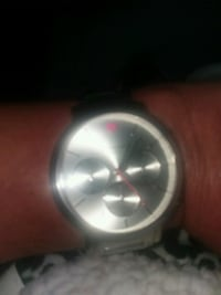 round silver-colored analog watch with link bracel Dallas