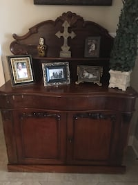 brown wooden cabinet and photo frames Houma, 70360