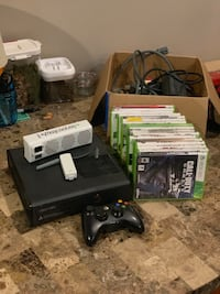 Xbox 360 + remote + intercooler + range extender + a lot of games Ossining