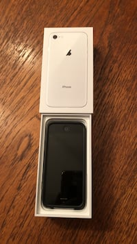 silver iPhone 8 box and black iPhone 5