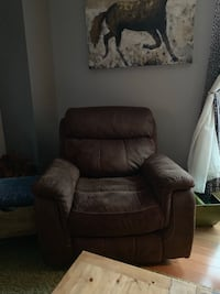 Brown chair new never sat in rocks or sits stationary recliner
