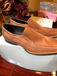 Pair of brown leather slip-on shoes Simpsonville, 29680