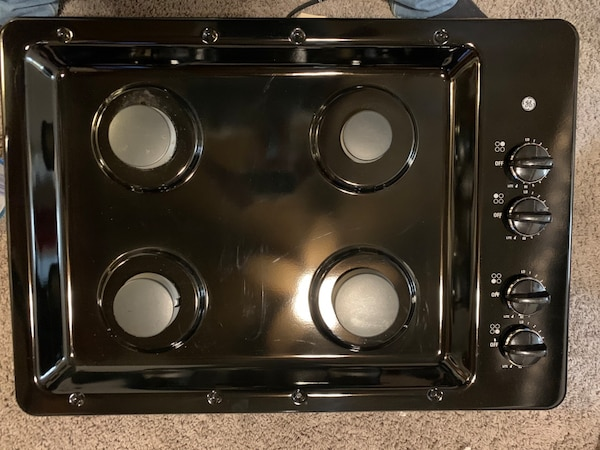 GE gas stove top b118dc8e-0502-467e-8911-99b5feb8f084