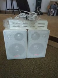 two white and gray speakers