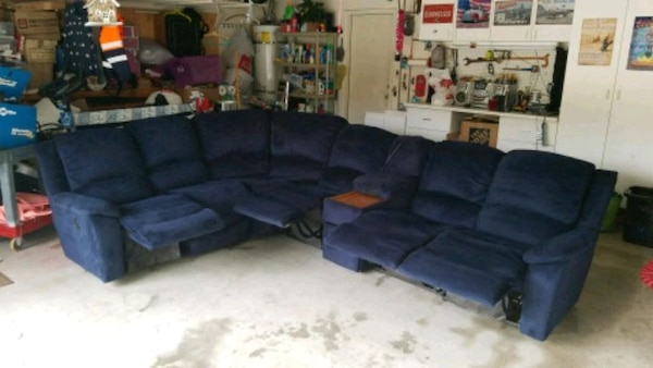 blue sectional sofa with ottoman