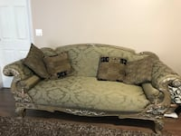 Gray and black floral fabric sofa