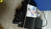 black Sony PS4 console with controller and game case Alexandria, 22306
