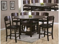 round brown wooden table with four chairs dining set Austin