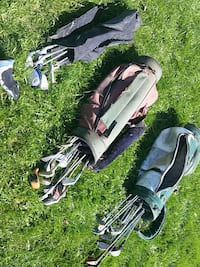 three assorted color golf bags with clubs sets Whitchurch-Stouffville