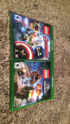 two Xbox One Lego Avengers and Jurassic World