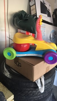 toddler's red and blue ride on toy 3746 km